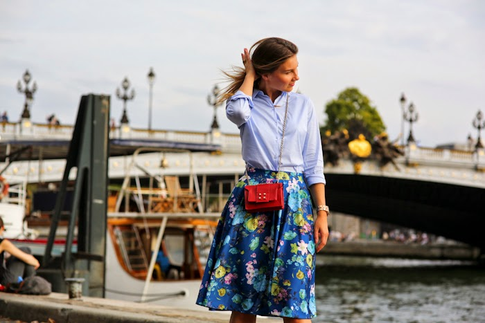 light blue shirt, floral skirt, manurina red bag