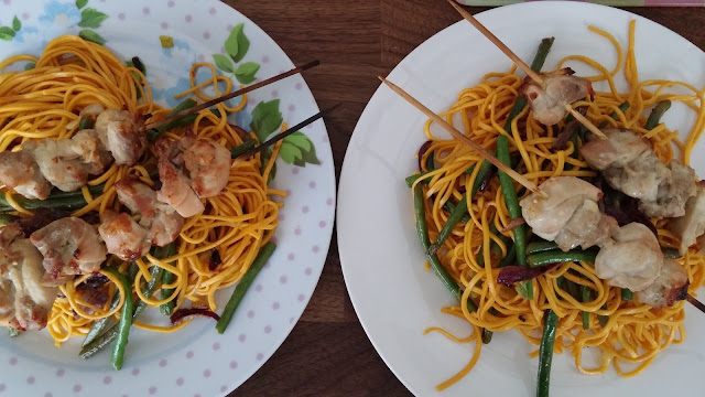 Chicken Yakitori with crispy red onions and sweet and sour noodles