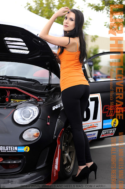 Valerie Valle in GXS Motorsports Marketing orange top at the Extreme Dimensions Charity Car Show Fullerton 2015