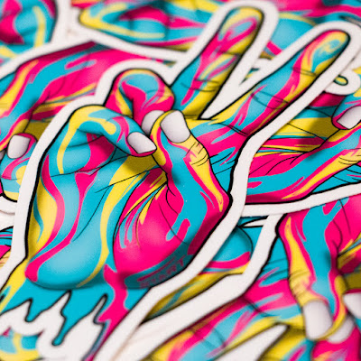 Vinyl Stickers of peace hand design by Shane Turner artist. Image is of a girl's hand making the peace sign. Made of colorful dripping psychedelic paint.