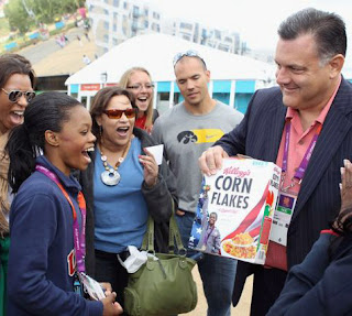 Gabby Douglas Is Presented With Her Corn Flakes Box