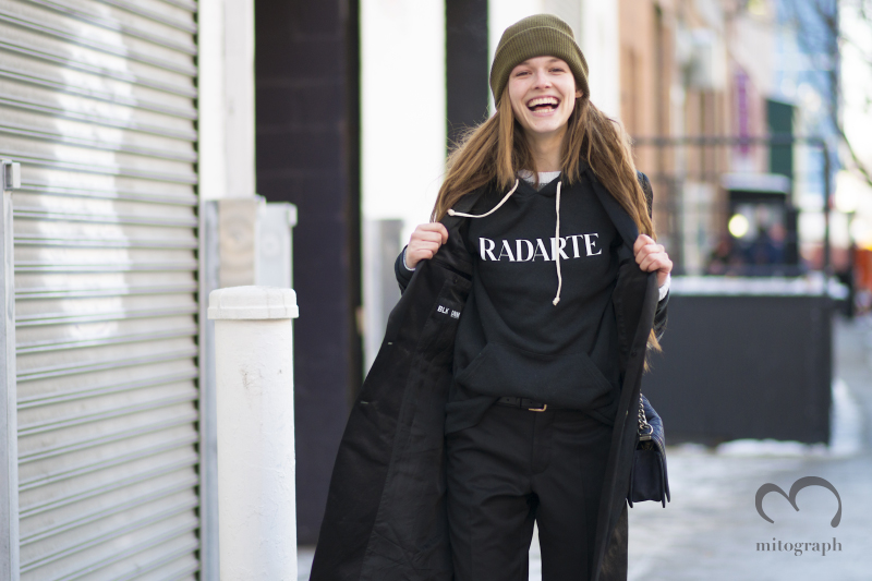 Model Emma Oak shows me a RODARTE sweater during New York Fashion Week NYFW