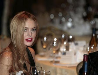 "Lindsay Lohan tweets about ""cute"" paramedics after exhaustion bout"
