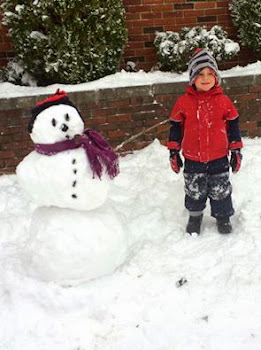 City Lad Makes a Snowman