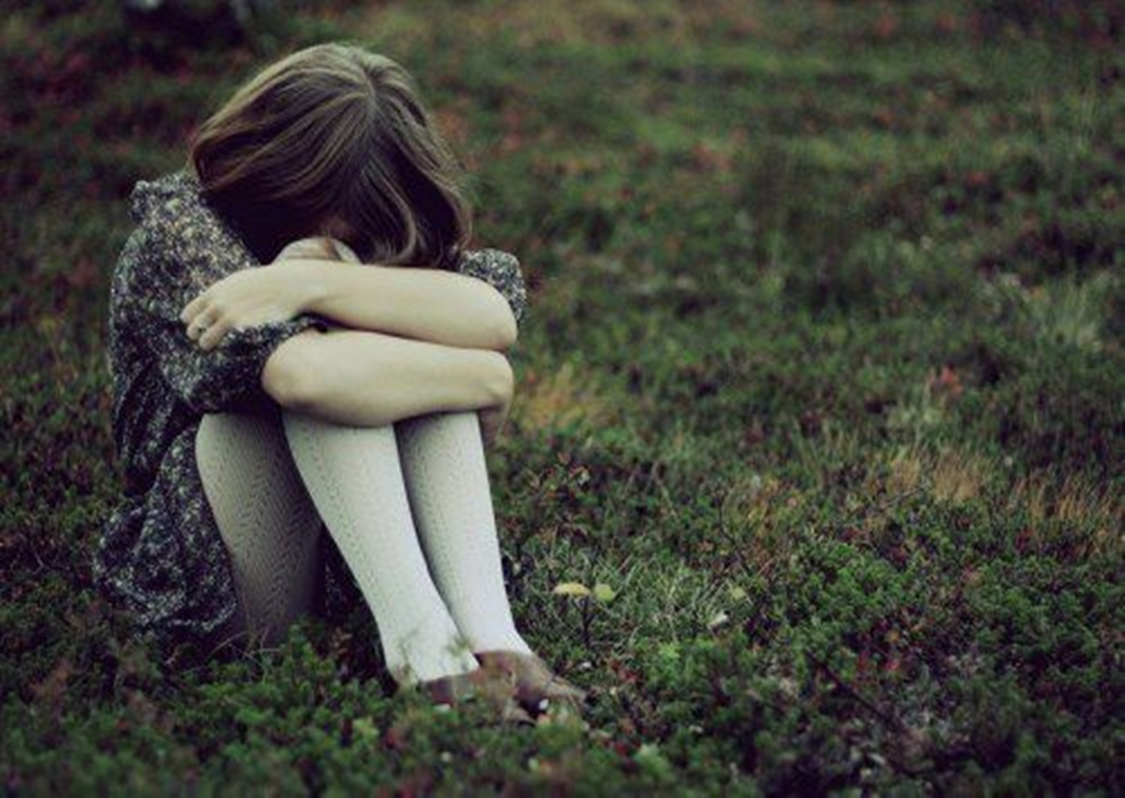 Lonely girl crying with tears in rain thinking of ... Sad