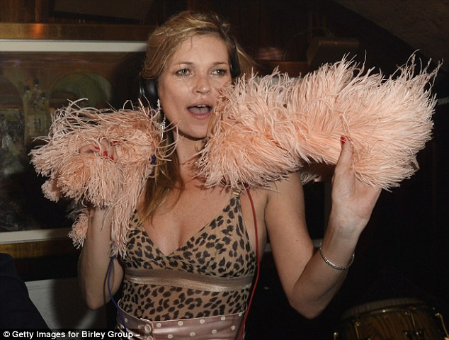 Kate Moss in vintage feather boa