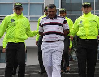 Policia Colombiana atrapa presunto narcotraficante vinculado a crimenes de policias