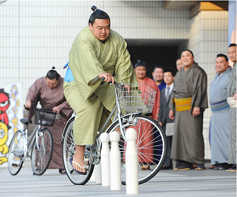 Sumo Wrestlers Attend Bicycle School in Tokyo