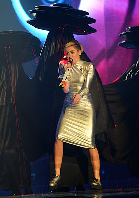 http://www.usmagazine.com/entertainment/news/miley-cyrus-opens-mtv-emas-with-alien-inspired-performance-grabs-dancers-boob-20131011