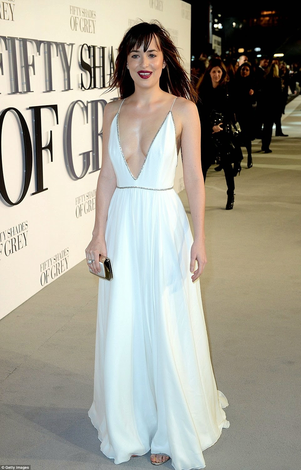 Dakota Johnson flaunts cleavage in a low-cut white dress at the 'Fifty Shades of Grey' London premiere