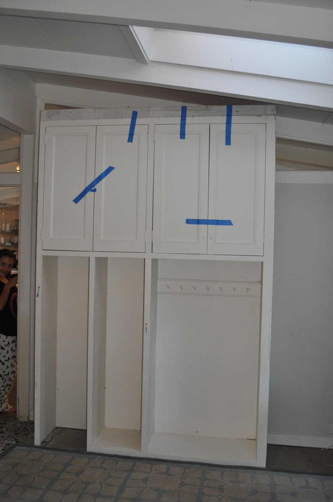 tre sorelle cottage: Entry way storage cabinet retrofit