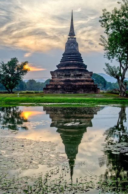Chedi reflections in Sukhotai Historical Park / Thailand
