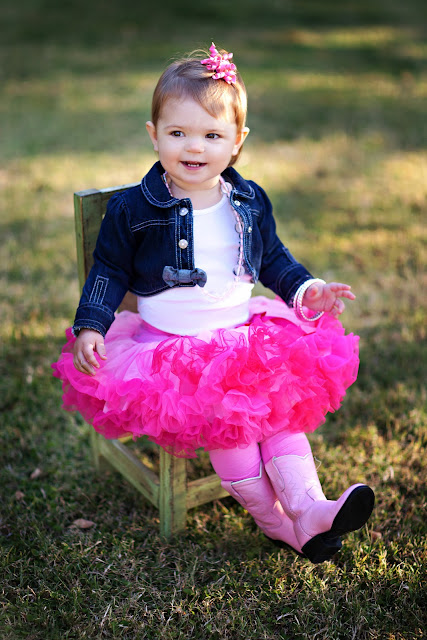 Baby girl modeling what to wear outfit during child photo session