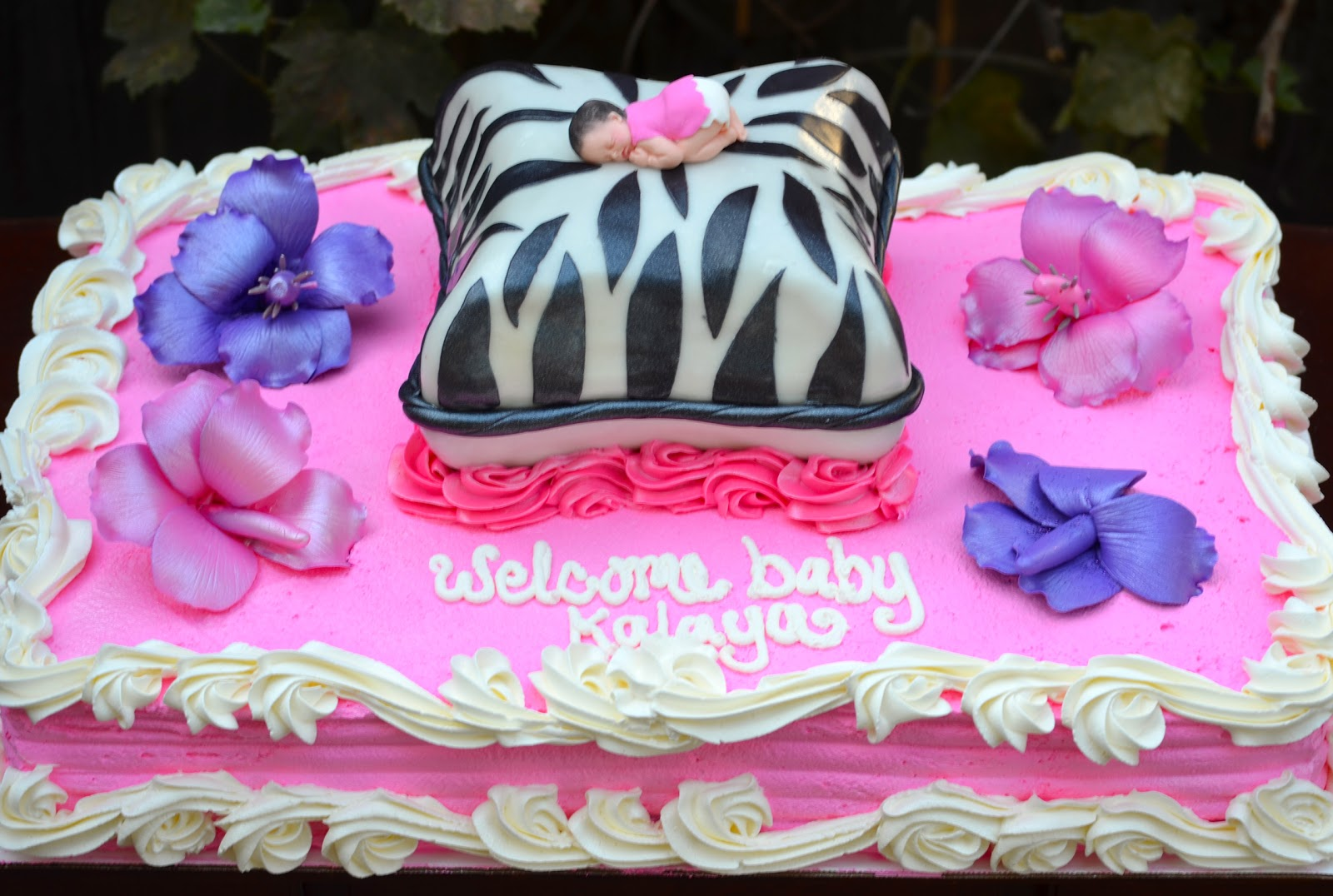 this is a 1 2 sheet cake with a small pillow cake on top