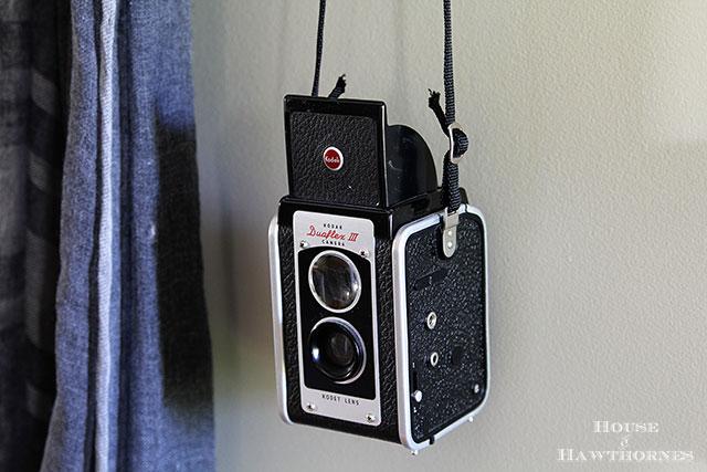 Vintage Kodak Duaflex III camera in an eclectic vintage entryway via houseofhawthornes.com