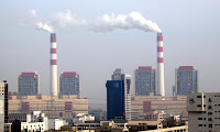 Smoke is emitted from chimneys at the Waigaoqiao coal-fired power plant in Pudong, Shanghai. (Photograph Credit: Imaginechina/Corbis) Click to Enlarge.