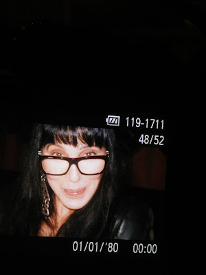 Cher, February 2013, sporting a pair of glasses and her real hair
