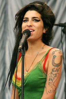 Tattoo designs tattoo of amy winehouse amy winehouse tattoos on the left side of her neck amy had a temporary tattoo of a dove this was to be one of the last tattoos amy had before her death urmus Image collections