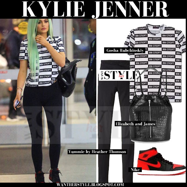 Kylie Jenner in white and black logo print tee, black leggings and red sneakers streetstyle what she wore