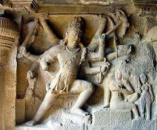 Shiva impaling Andhaka; Stone temple carving Ellora.