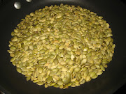Combine the toasted pumpkin seeds, basil, spinach, and garlic in a food .