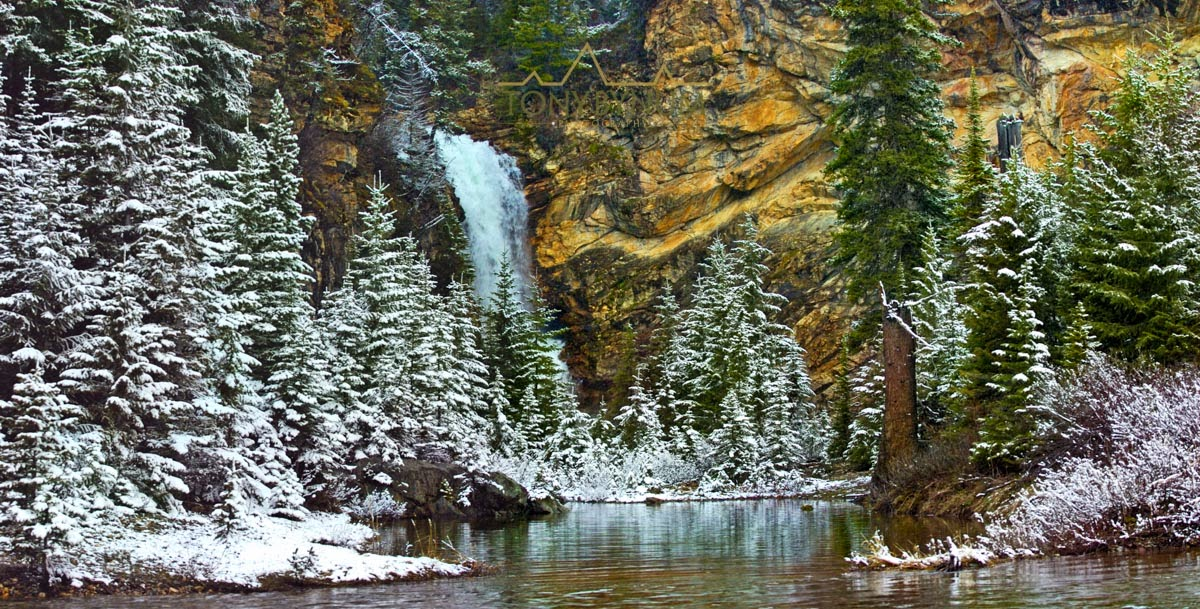 Running Eagle Falls with fresh snow, Glacier National Park, Montana