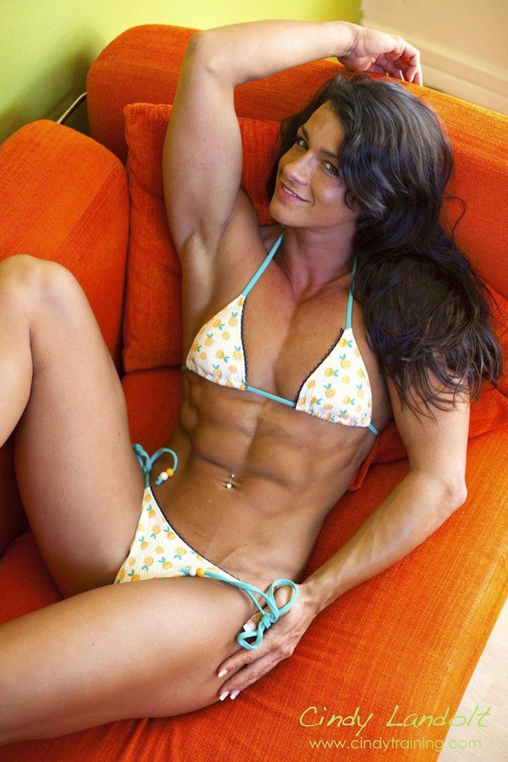 Cindy Landolt Flexing Her Ripped Abs, Chest And Biceps In A Bikini