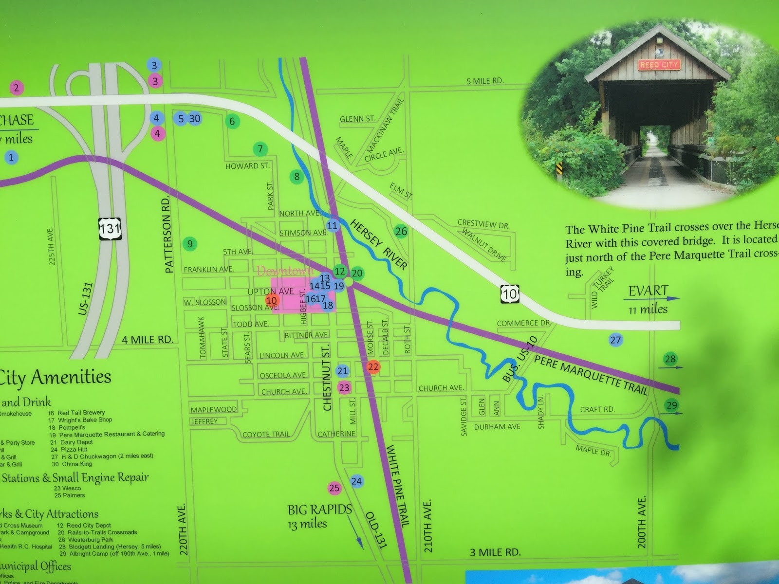 the above map shows two bicycle trails in purple the east west trail is the pere marquette trail and the north south trail is the white pine trail