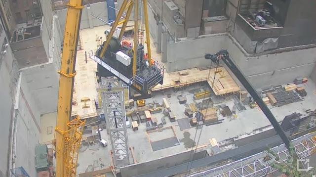 Photo of crane parts joining together up on the crane