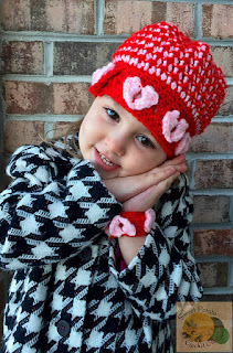 http://www.ravelry.com/patterns/library/pop-goes-my-heart-beanie