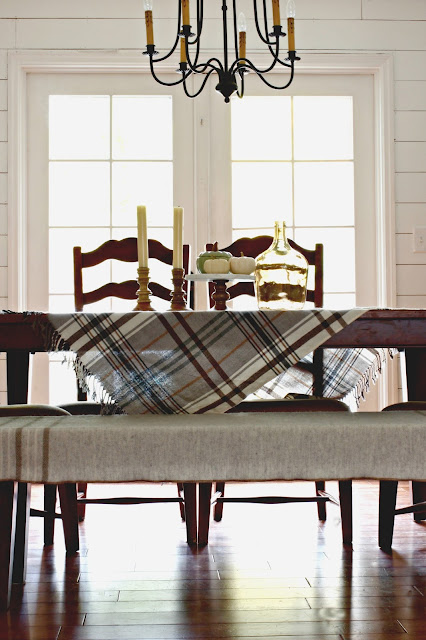 Brondy chandelier in farmhouse style dining room with white planking - www.goldenboysandme.com