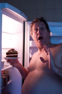 Overweight Man Eating Cake