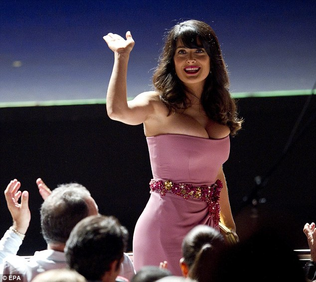 Salma Hayek squeezes into skin-tight pink gown