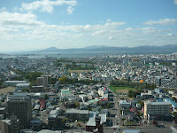 Hakodate city with ocean and mountains in the background as seen from Goryokaku Tower