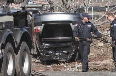 NYC road accident - car flip into Steinway creek