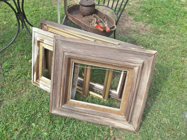 of old solid wood frames that look like they were made from barn wood