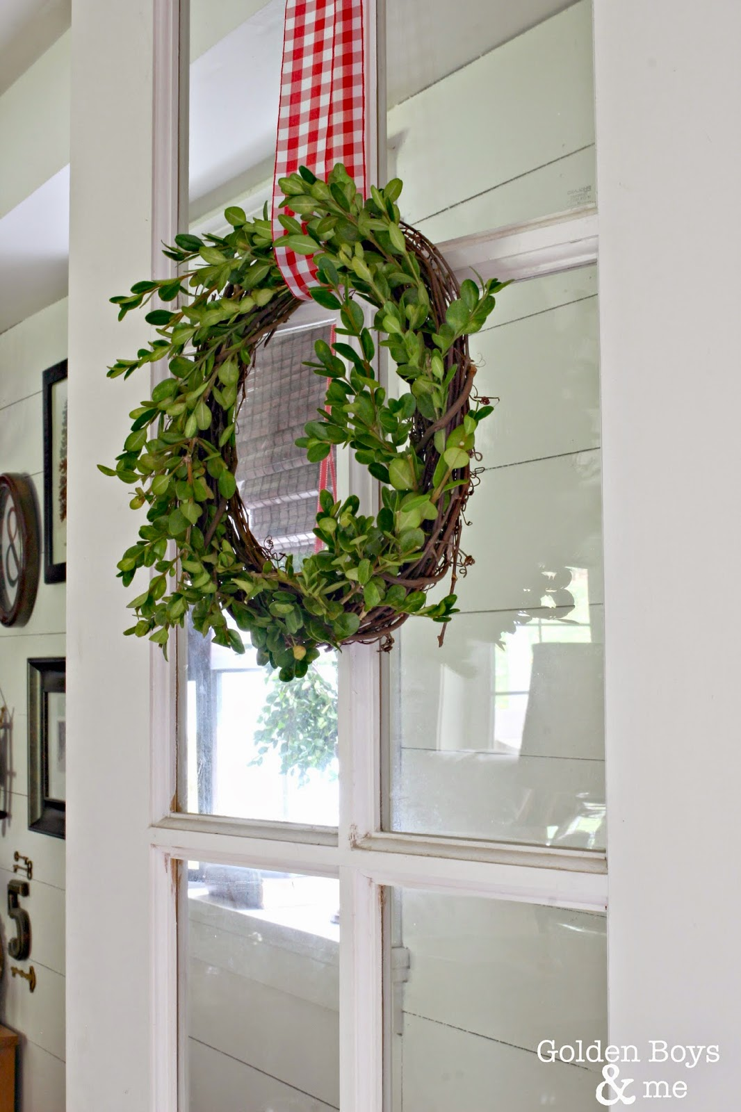 DIY boxwood wreath on french door with plank wall behind-www.goldenboysandme.com