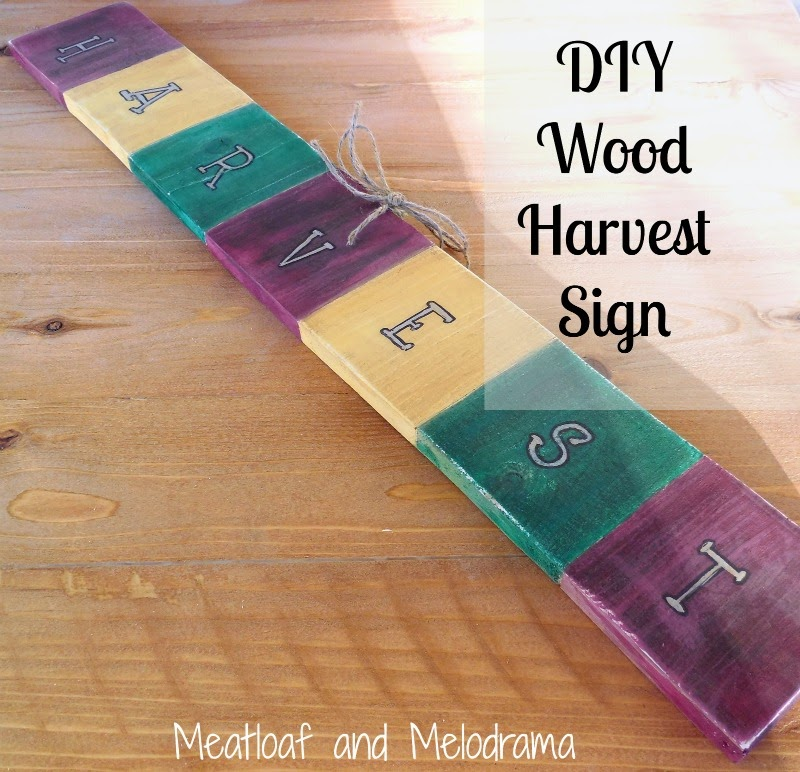 hand painted wood harvest sign with hand lettering in bright fall colors