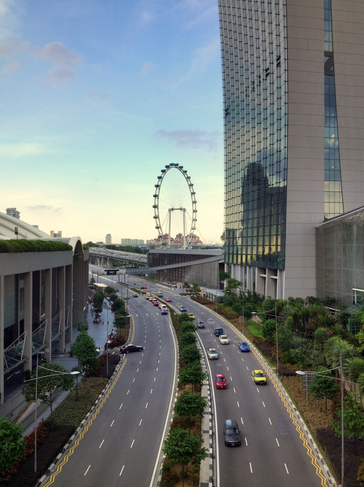 walking along the way from marina bay sands fourth level to the gardens by the bay give a best experience of the atmosphere of both city and garden mixed