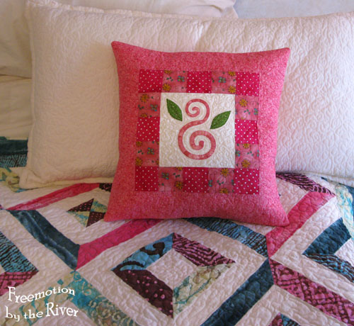 Pillow on my quilt