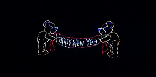 light display of two bears holding a happy new year banner