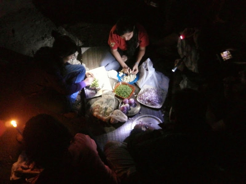 The ladies helped in cutting the vegetables for our dinner in the cave in Alang