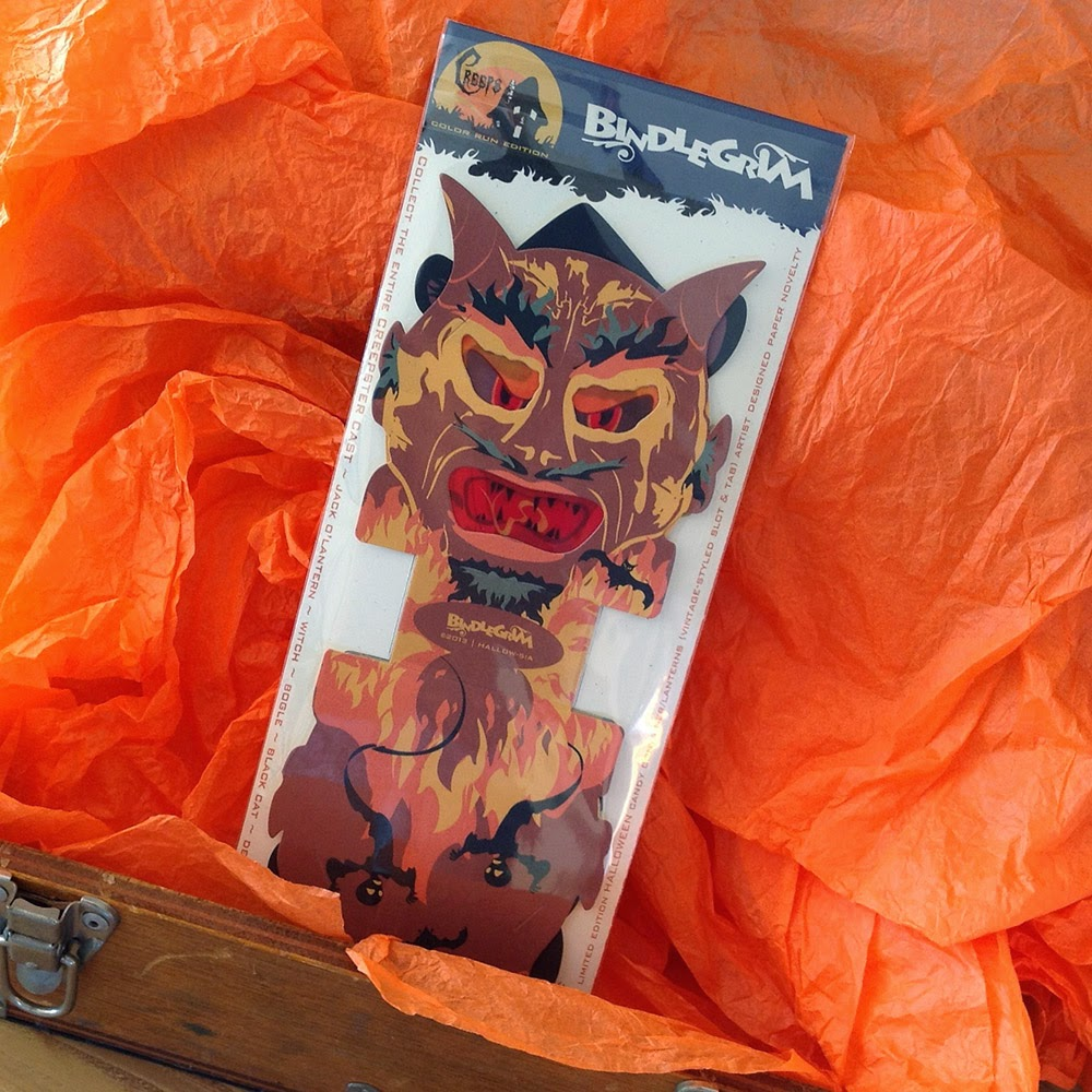 Orange crepe paper and wooden box display paper devil gift-box candy-cotainer lantern in a vintage-style Halloween design.