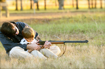 Father teaching his infant son, how to shoot a firearm, before he is even in elementary school!.