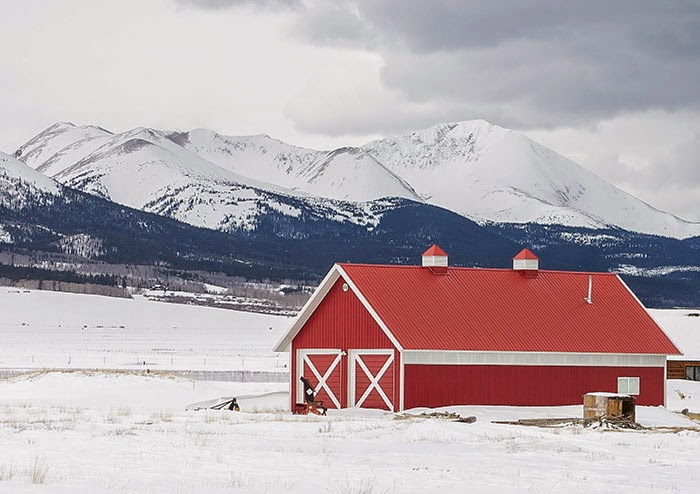 Mount Guyot from Highway 285 with red barn in winter