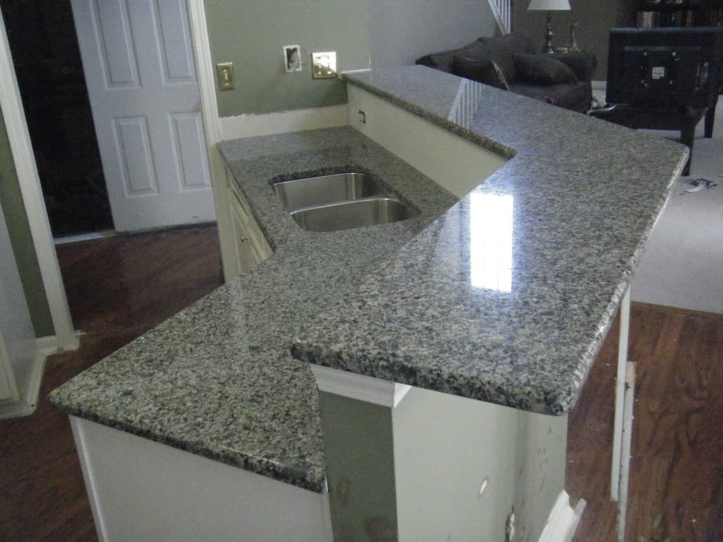 New Caledonia Granite Countertop with White Cabinets