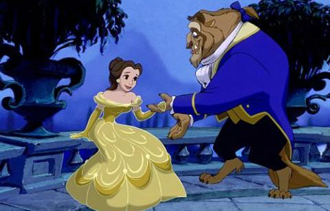 The Beast taking Belle's hand in Beauty and the Beast