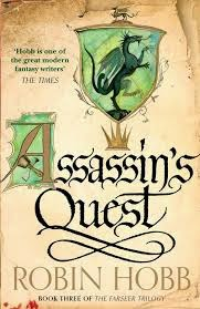 cover art for Assassin's Quest, featuring green heraldic dragon on what is meant to look like an illuminated manuscript page