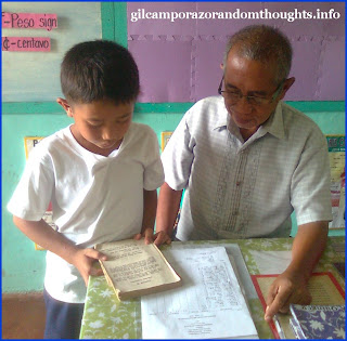 Pupil reading conducted by the school head