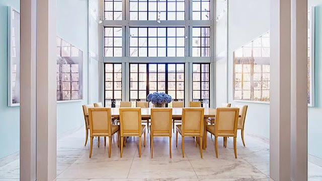open dining room design with floor to ceiling windows white walls